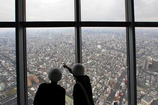 Reporters observe a panoramic view of the city of Tokyo.