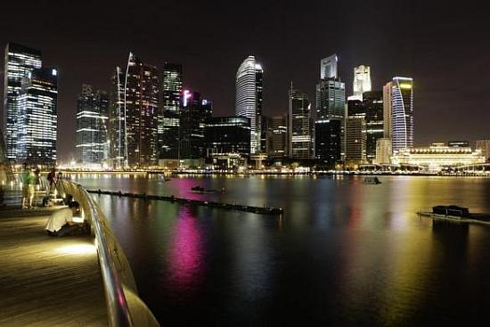 The skyscrapers of Singapore's central business district are pictured before Earth Hour.