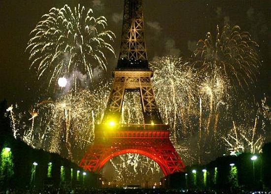 Fireworks burst over the Eiffel Tower as France celebrates Bastille Day in Paris.