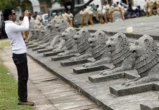 A tourist takes photos of the Independence square in Colombo.