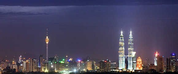 Malaysia's landmark Petronas Twin Towers stand tall in the heart of the capital Kuala Lumpur.