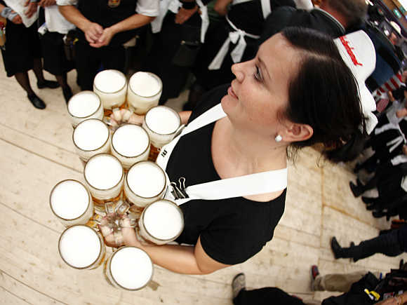 A waitress serves beers during the opening ceremony of the Oktoberfest in Munich, Germany.