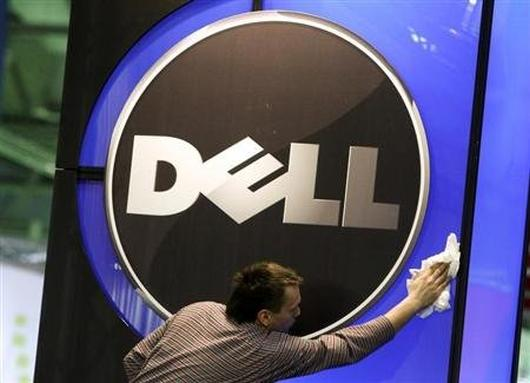 A man wipes the logo of the Dell.