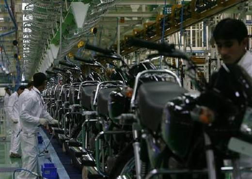 Employees work in an assembly line at Hero MotoCorp's plant in Haridwar.