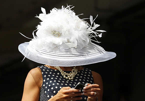 A race fan checks her phone before the 138th running of the Kentucky Derby at Churchill Downs in Louisville, Kentucky, United States.