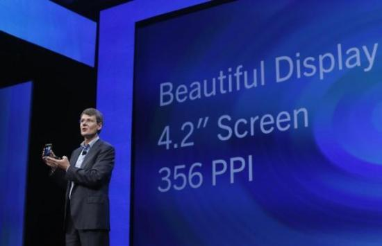 BlackBerry president and chief executive Thorsten Heins introduces a new device.