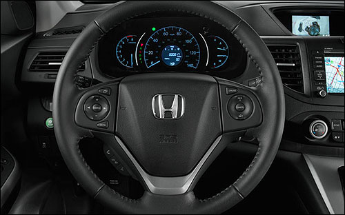 Steering wheel-mounted controls help the driver command more than just the road.