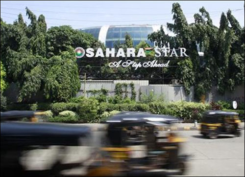 Auto-rickshaws move past a Sahara Star hotel in Mumbai.