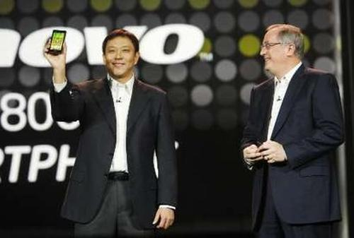 Liu Jun, president (business group) of Lenovo, shows K800 smartphone.