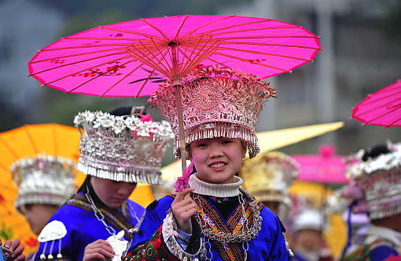 An ethnic Miao woman wearing her traditional headwear made of silver on the Miao's New