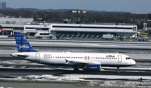 A JetBlue aircraft makes its way from the terminal at JFK International Airport in New York, United States.