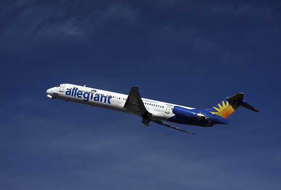 An Allegiant Air MD-83 passenger jet takes off from the Monterey airport in Monterey, California, United States.