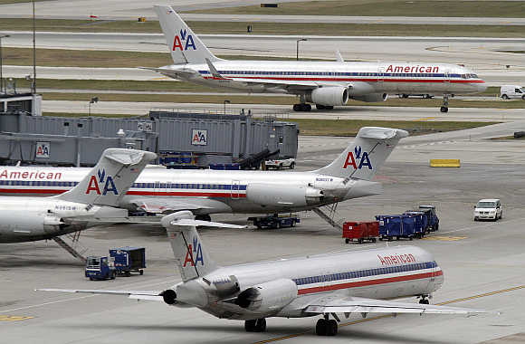 American Airlines planes sit at their gates while others taxi for arrival and departure at O'Hare International airport in Chicago, United States.