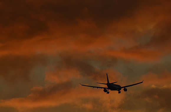 A passenger plane flies in to land at Heathrow Airport in west London, United Kingdom.
