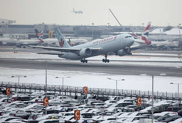 An Air Canada aircraft takes off after snowfall at Heathrow Airport in London, United Kingdom.