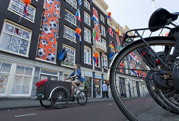 A woman rides her bicycle in Amsterdam.
