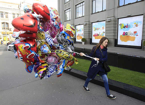 A woman carries balloons in central Moscow.