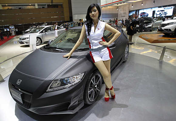 A model stands next to a Sport Hybrid New Honda CR-Z in Jakarta, Indonesia. Photo is for representation purpose only.