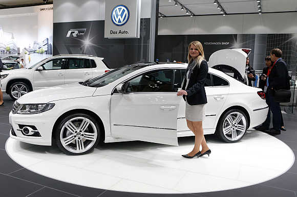 A model poses next to a Volkswagen CC R-line in Leipzig, Germany. Photo is for representation purpose only.