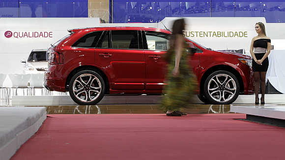 A model walks past a Ford Edge in Sao Paulo, Brazil. Photo is for representation purpose only.