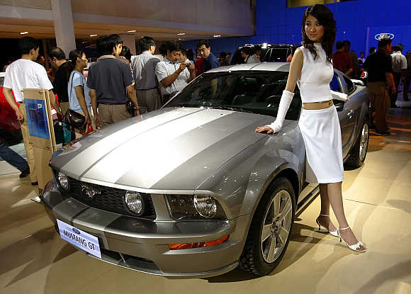 A Chinese model poses with a Ford Mustang GT in Beijing. Photo is for representation purpose only.