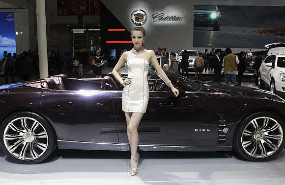 A model stands next to a Cadillac CIEL concept car in Beijing. Photo is for representation purpose only.