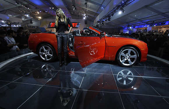 A model stands beside a General Motors Chevrolet Camaro car during India's Auto Expo in New Delhi. Photo is for representation purpose only.