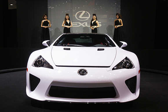 Models pose behind a Lexus LFA in Bangkok, Thailand. Photo is for representation purpose only.