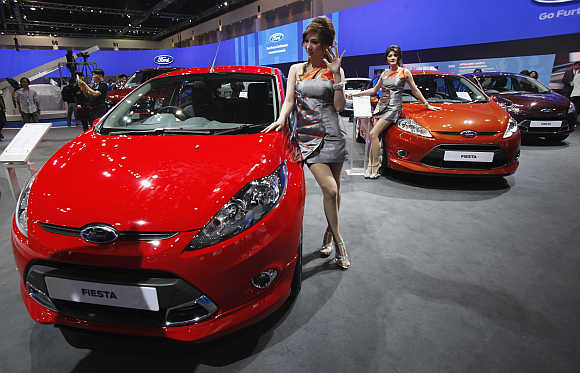 A model poses beside a Ford Fiesta in Bangkok, Thailand. Photo is for representation purpose only.