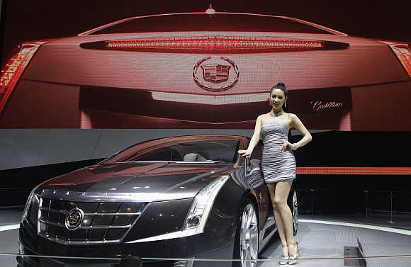 A model stands next to a Cadillac ELR in Beijing. Photo is for representation purpose only.