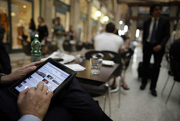 A man uses his iPad tablet in Rome, Italy.