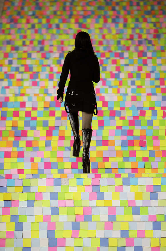 A girl walks upstairs at the CeBIT computer fair in Hanover, Germany.