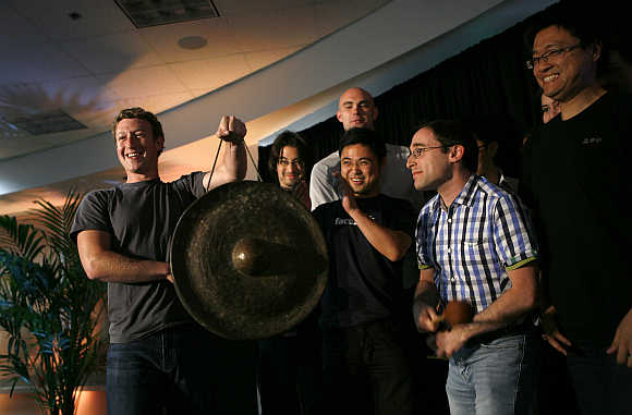 Mark Zuckerberg holds a gong at Facebook headquarters in Palo Alto, California