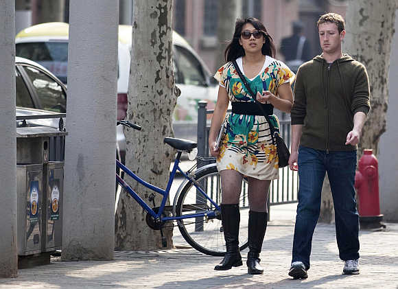 Mark Zuckerberg with his wife Priscilla Chan on Fuxing Road in Shanghai.