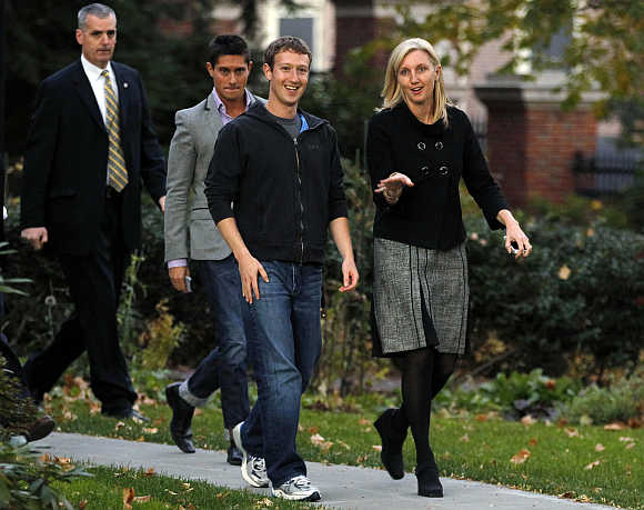 Mark Zuckerberg walks out to speak to reporters at Harvard University in Cambridge, Massachusetts.