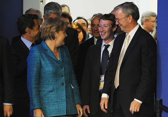 German Chancellor Angela Merkel with Mark Zuckerberg and Google CEO Eric Schmidt in Deauville, France.