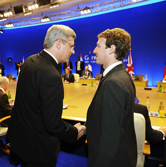Mark Zuckerberg shakes hands with Canada's Prime Minister Stephen Harper in Deauville, France.