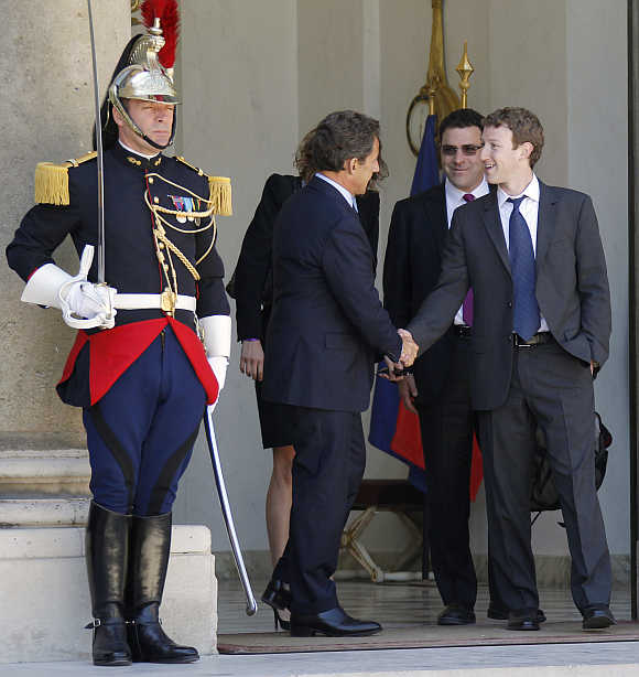 France's then-president Nicolas Sarkozy shakes hands with Mark Zuckerberg at the Elysee Palace in Paris.