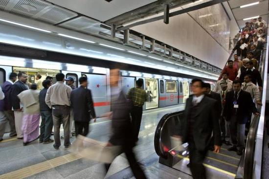 Commuters arrive to an underground metro train station.
