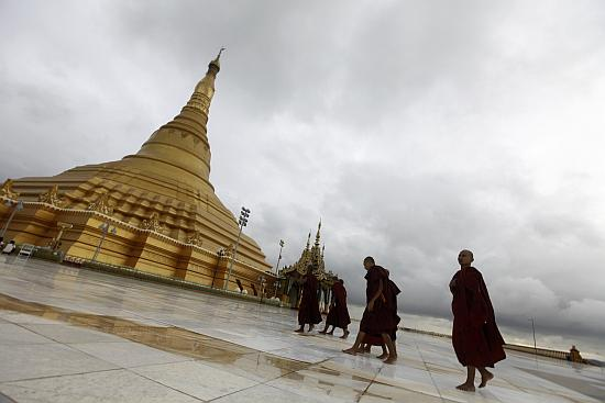 Buddhist monks visit the Uppatasanti pagoda in Myanmar. As the country moves away from authoritarian rule it may not give preference Indian companies.