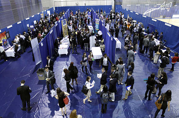 American University students walk among recruiting booths during a career job fair at American University in Washington, DC.