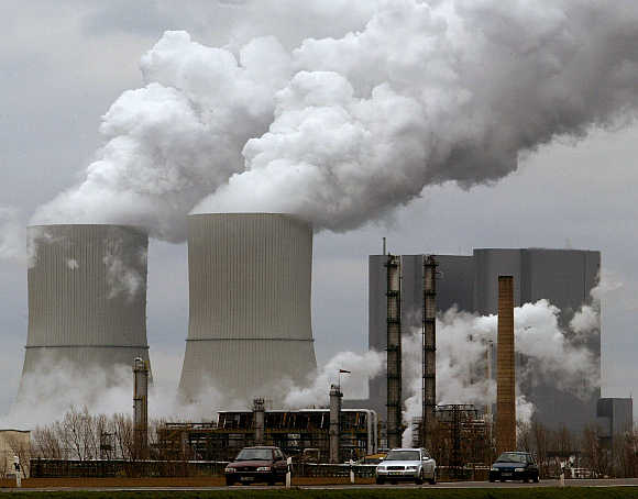 Cars drive past a plant of US chemical producer Dow near the eastern German village of Lippendorf south of Leipzig.