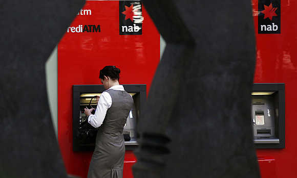 A woman uses a National Australia Bank ATM in central Sydney.