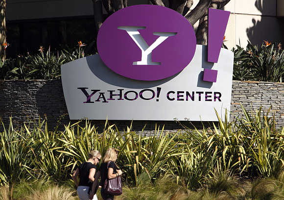 Women walk past Yahoo office in Santa Monica, California.