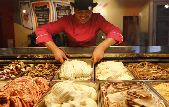 Ice-cream maker Matthias Muenz arranges white sausage and beer flavoured ice-cream in his shop 'The crazy icecream maker' in Munich, Germany/