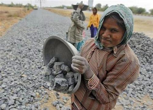 A labourer works at a road construction site in Ahmedabad.