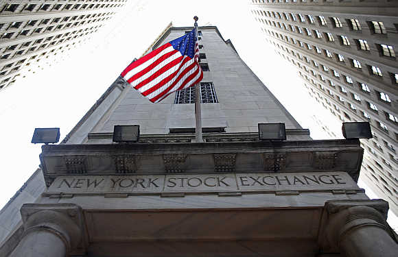A flag flutters in the wind outside the New York Stock Exchange.