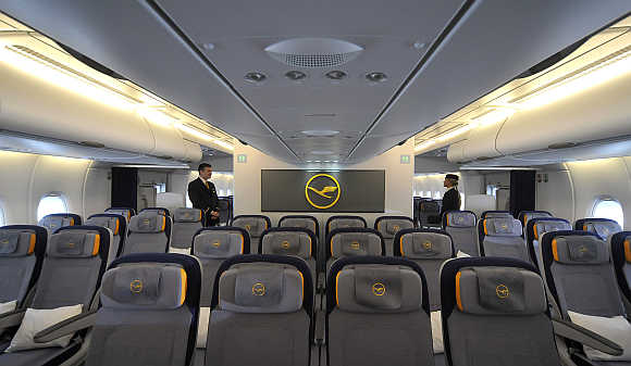 Flight attendants in Lufthansa's Airbus A380 Economy Class in Finkenwerder, near Hamburg, Germany.