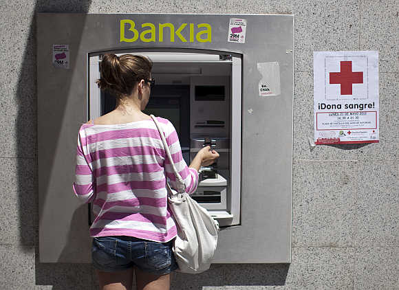 A woman at an ATM in Madrid, Spain.