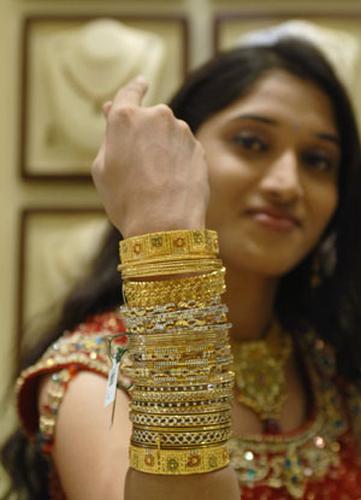 Model displays gold jewelry ahead of the Hindu festival of Akshaya Tritiya.